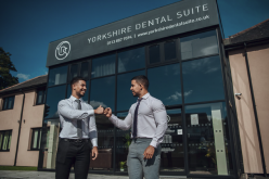 TWIN BODYBUILDING DENTISTS SET OUT TO PUT A SMILE ON THE FACE OF THE NATION